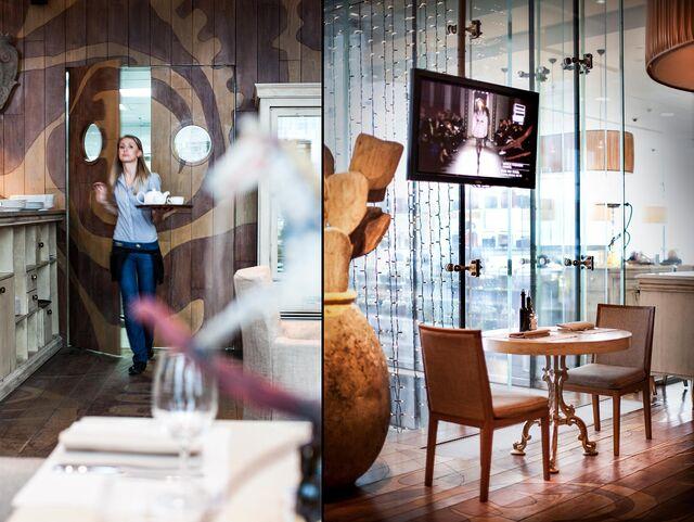 Фотосъемка интерьера ресторана Bocconcino. Официант в интерьере ресторана.
